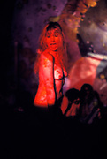 An excited, naked girl, dancing, covered by red light projections, UFO Psychedelic Cluc London, UK 1970