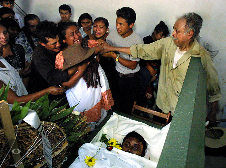 In a fit of uncontrollable grief Ofelia Poot loses control with husband Pedro Zumarraga Mejia (right) and others attempting to pacify her. Her son Jose' Mejia was shot and killed by Portland Police after an epeleptic fit was mistaken for agression. His body was flown back home to Mani, Mexico, for burial.
