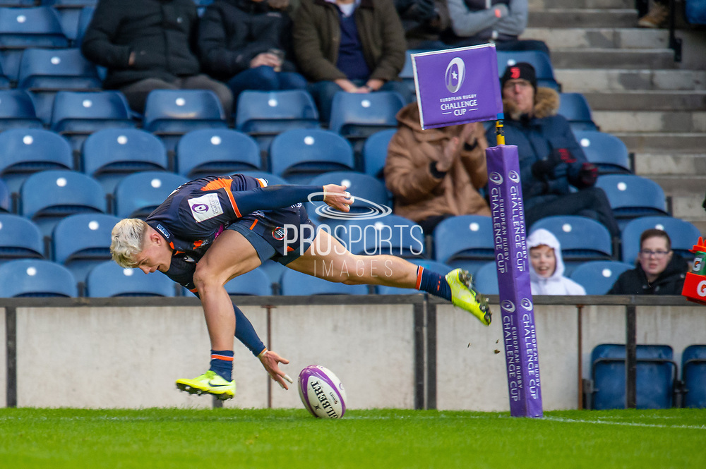 Darcy Graham (#14) of Edinburgh Rugby touches down to score his third try during the European Rugby Challenge Cup match between Edinburgh Rugby and SU Agen at BT Murrayfield, Edinburgh, Scotland on 18 January 2020.