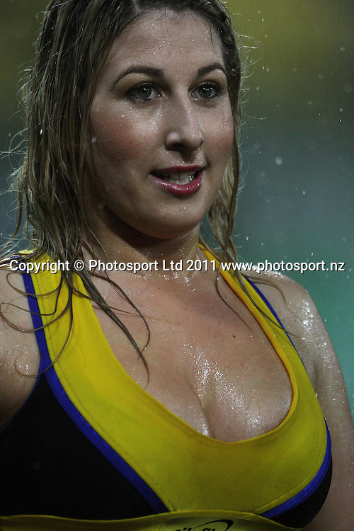 A Hurricanes cheerleaders braves the weather. Super 15 rugby match - Crusaders v Hurricanes at Westpac Stadium, Wellington, New Zealand on Saturday, 18 June 2011. Photo: Dave Lintott / photosport.co.nz
