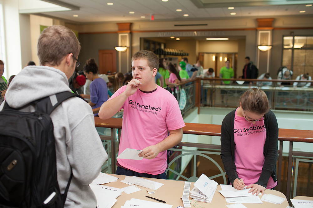 Dan Maloney explains the process to students at the Got Swabbed event in the Baker Center at Ohio University on Tuesday, October 15, 2013. Photo by Chris Franz