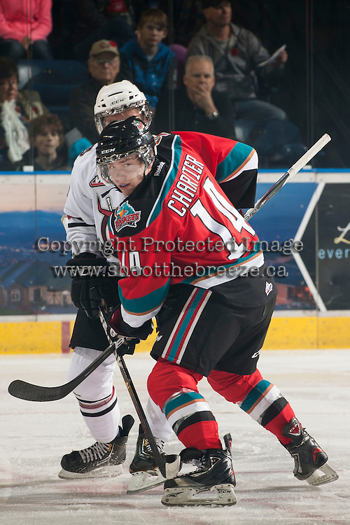 KELOWNA, CANADA - NOVEMBER 9:  Rourke Chartier #14 of the Kelowna Rockets blocks a player from the Red Deer Rebels at the Kelowna Rockets on November 9, 2012 at Prospera Place in Kelowna, British Columbia, Canada (Photo by Marissa Baecker/Shoot the Breeze) *** Local Caption ***