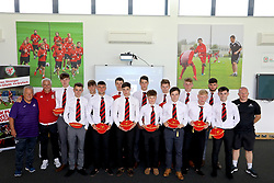 NEWPORT, WALES - Sunday, May 28, 2017: Welsh College players with their caps for participation during day three of the Football Association of Wales' National Coaches Conference 2017 at Dragon Park. Ian Rush, Marc Lloyd Jones. (Pic by Mark Roberts/Propaganda)