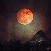 Photomanipulation / collage: Full blood moon over a dark mountain range<br /> Society6 Prints: http://bit.ly/2oGzjAL