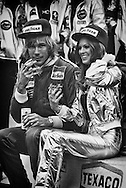British 1976 World Champion James Hunt, a Schlitz and cigarette in hand and Penthouse Pet by his side, relaxes on his still warm Marlboro McLaren M26 after winning the 1977 United States Grand Prix at Watkins Glen. <br /> <br /> Talented McLaren driver James Hunt was one of the most complicated, charismatic and controversial individuals ever to compete in Formula One. He loved projecting his playboy image to the hilt and backed it up with outrageous statements, never-give-up speed on-track and a very full life off-track. <br /> <br /> A year earlier, he had been involved in one of the most dramatic episodes in the history of Formula One as he battled with two-time world Champion Niki Lauda down to the final race in Japan for the 1976 World Driver's Championship. <br /> <br /> This year, he repeated his 1976 US Grand Prix victory, but it was great friend Lauda who had taken back the title for his second of an eventual three World Driver's Championships.