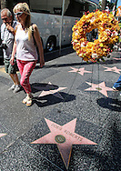Tourists walk past a memorial wreath left on Doris Roberts's star on the Hollywood Walk of Fame in Los Angeles on Tuesday April 19, 2016. Roberts, the five-time Emmy winner best known for playing Ray Romano's overbearing mother on the comedy hit ``Everybody Loves Raymond,&rsquo;&rsquo; died peacefully in her sleep of natural causes in Los Angeles on Sunday, according to her family. She was 90.<br /> (Photo by Ringo Chiu/PHOTOFORMULA.com)<br /> <br /> Usage Notes: This content is intended for editorial use only. For other uses, additional clearances may be required.