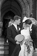 "05/09/1962<br /> 09/05/1962<br /> 05 September 1962<br /> Wedding of Fergus Keogh of ""Eagleville"", Strandville Avenue, Clontarf, Dublin to Miss Miriam Caffrey, Church Avenue, Drumcondra Dublin at the Church of the Visitation of the BVM, Fairview with reception at St. Lawrence Hotel, Howth. Mr. keogh was full-back for Bective Rangers at the time. picture shows best man at the wedding, Joe McGowan (vice captain of Bective Rangers Rugby team and  captain of the Wolfhounds team to play Oxford-Cambridge the next week) kissing the bride after the ceremony."
