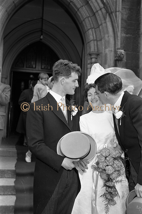 """05/09/1962<br /> 09/05/1962<br /> 05 September 1962<br /> Wedding of Fergus Keogh of """"Eagleville"""", Strandville Avenue, Clontarf, Dublin to Miss Miriam Caffrey, Church Avenue, Drumcondra Dublin at the Church of the Visitation of the BVM, Fairview with reception at St. Lawrence Hotel, Howth. Mr. keogh was full-back for Bective Rangers at the time. picture shows best man at the wedding, Joe McGowan (vice captain of Bective Rangers Rugby team and  captain of the Wolfhounds team to play Oxford-Cambridge the next week) kissing the bride after the ceremony."""