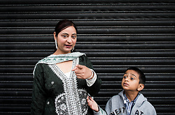 © Licensed to London News Pictures. <br /> 06/06/2014. <br /> <br /> Middlesbrough, England<br /> <br /> A woman and her son in Middlesbrough town centre look on as a parade takes place through the town to launch the 24th Middlesbrough Mela event.<br /> <br /> The Middlesbrough Mela has become the largest and most spectacular multicultural festival in the North East.<br /> <br /> Photo credit : Ian Forsyth/LNP