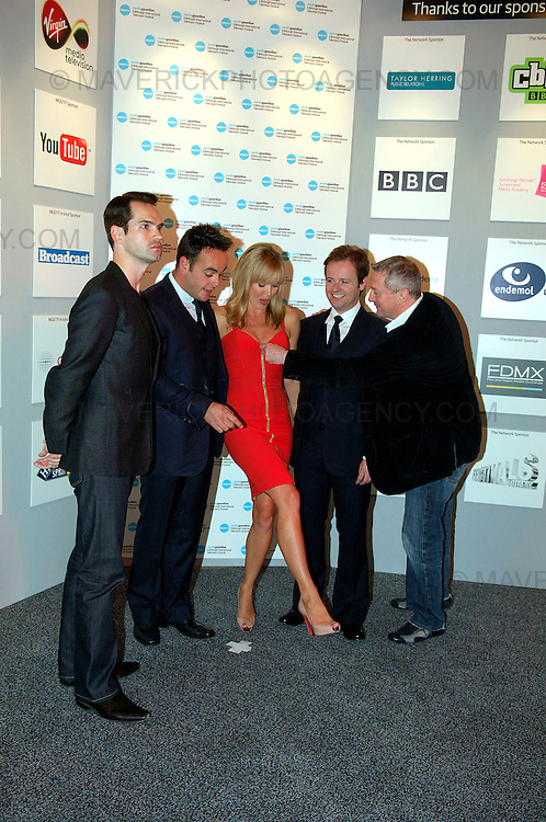 Britains Got Talent judges attend the Media Guardian Edinburgh International Television Festival at the Edinburgh International Conference Centre today...Picture shows Louie Walsh attempts to pull down the zip on Amanda Holdens dress. From left Jimmy Carr with Britains Got Talent judges Decs, Amanda Holden, Ants and Loiue Walsh