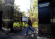 © Licensed to London News Pictures. 22/04/2012. Hammersmith, UK . A women walks out of the gate. General Views taken today 22 April 2012 of Hammersmith Cemetery. Doctors are battling to save the sight of a senior British diplomat mugged while walking through the cemetery on Friday night (20/04/12). Bermuda's new Governor George Fergusson may lose his vision in his left eye after being attacked by a man in Hammersmith Cemetery, west London, said police. Photo credit : Stephen Simpson/LNP