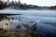 .Warm temperatures in nothern Wisconsin caused fog to develop on the still frozen lakes.