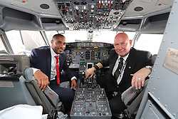 CARDIFF, WALES - Saturday, June 4, 2016: Wales' captain Ashley Williams with flight captain Steve Hunt in the cockpit as the team depart from Cardiff Airport heading to Sweden for their last friendly before the UEFA Euro 2016 in France. (Pic by David Rawcliffe/Propaganda)