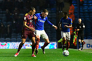 Ronan Curtis (11) of Portsmouth battles for possession with Kayden Jackson (9) of Ipswich Town during the EFL Sky Bet League 1 match between Portsmouth and Ipswich Town at Fratton Park, Portsmouth, England on 21 December 2019.