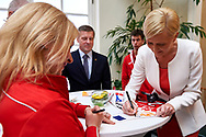 Warsaw, Poland - 2017 March 31: (R) First Lady Agata Kornhauser-Duda signs her photocards for Special Olympics Athletes while meeting at Polish President's Palace on March 31, 2017 in Warsaw, Poland.<br /> <br /> Mandatory credit:<br /> Photo by © Adam Nurkiewicz / Mediasport<br /> <br /> Adam Nurkiewicz declares that he has no rights to the image of people at the photographs of his authorship.<br /> <br /> Picture also available in RAW (NEF) or TIFF format on special request.<br /> <br /> Any editorial, commercial or promotional use requires written permission from the author of image.<br /> <br /> Image can be used in the press when the method of use and the signature does not hurt people on the picture.