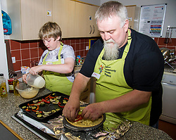 Pictured: Sean Fitzharris brings his autistic son Malcom (11) along to the classes to help with the problems his son has with eating.  Being allowed to develop his own sauce has improved the eating situation at home and in the future.<br /> <br /> Public Health Minister Aileen Campbell joined a class at the Pilton Community Health Project which helps families gain confidence in the kitchen, ahead of the Scottish Government's consultation on its diet and obesity strategy being launched in the autumn<br /> Ger Harley | EEm 10 August  2017