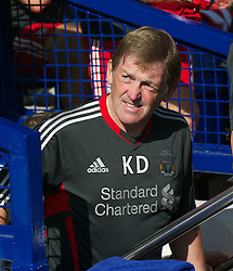 LIVERPOOL, ENGLAND - Saturday, October 1, 2011: Liverpool's manager Kenny Dalglish walks out to face Everton during the Premiership match at Goodison Park. (Pic by David Rawcliffe/Propaganda)