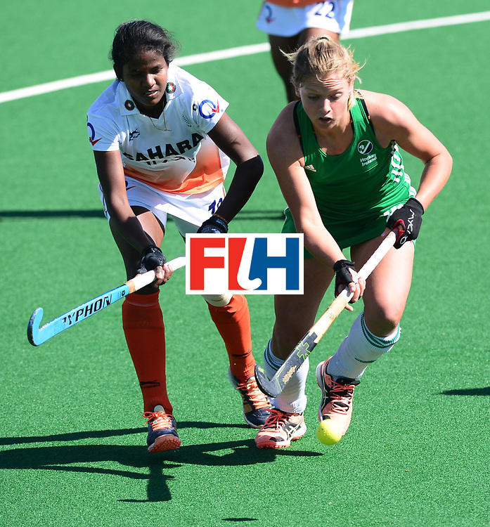 JOHANNESBURG, SOUTH AFRICA - JULY 22: Namita Toppo of India and Chloe Wathins of Ireland during day 8 of the FIH Hockey World League Women's Semi Finals 7th-8th place match between India and Ireland at Wits University on July 22, 2017 in Johannesburg, South Africa. (Photo by Getty Images/Getty Images)