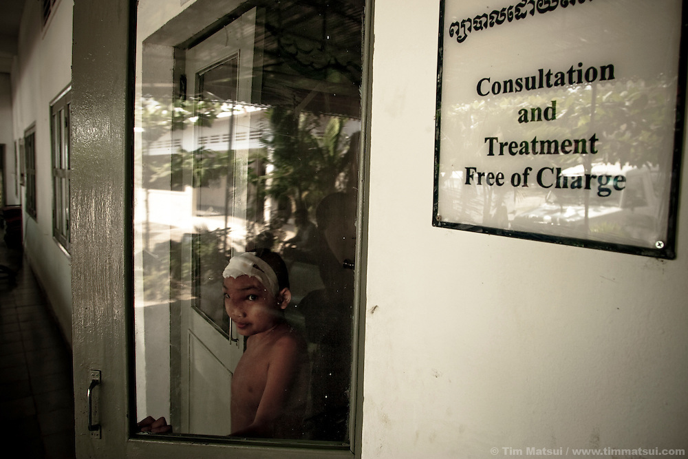 A Cambodian child emerges from the Children's Surgical Center, a medical facility on the outskirts of Phnom Penh, Cambodia, providing free medical services. The CSC also serves as a burn treatment center, both immediate and long term, particularly for victims of acid attack.