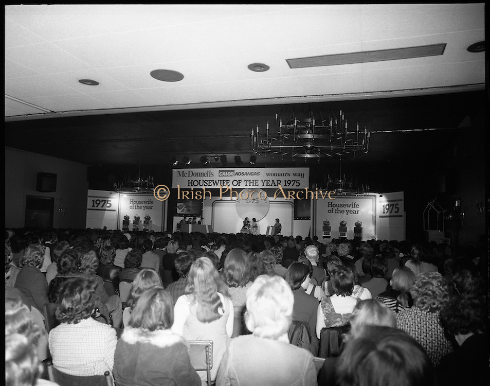 Housewife Of The Year Final.        (J91).1975..25.11.1975..11.25.1975..25th November 1975..The Housewife Of The Year Final took place today at Jury,s Hotel,Ballsbridge,Dublin. The event was sponsored by Mc Donnells, Calor/Kosangas and Woman's Way magazine. The show was compered by Mr Mike Murphy from RTE..The finalists were:.Mrs Geraldine Cronin,Nenagh,Co Tipperary..Mrs Deirdre Dolan,Passage West,Co Cork..Mrs Barbara Hartigan,Castleconnell,Co Limerick..Mrs Frances Twomey,Castlebar, Co Mayo..Mrs Susanne Browne,Lifford, Co Donegal..Mrs Lilian Murphy, Dunshaughlin,Co Meath..Mrs Eileen Jones,Donabate, Co Dublin..The sevenfinalists were selected from a group of eighty four entrants.The cookery section was judged by Paula Daly,McDonnell's Good Food Kitchen,Liz Boyhan,Calor Kosangas and Honor Moore, Woman's Way..A view of the stage as Mike Murphy introduces the contestants.