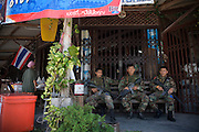 Thai army soldiers taking a rest outside a mini market. Thailand is struggling to keep up appearances as the land of smiles has to face up to its troubled south. Since 2004 more than 3500 people have been killed and 4000 wounded in a war we never hear about. In the early hours of January 4th 2004 more than 50 armed men stormed a army weapons depot in Narathiwat taking assault rifles, machine guns, rocket launchers, pistols, rocket-propelled grenades and other ammunition. Arsonists simultaneously attacked 20 schools and three police posts elsewhere in Narathiwat. The raid marked the start of the deadliest period of armed conflict in the century-long insurgency. Despite some 30,000 Thai troops being deployed in the region, the shootings, grenade attacks and car bombings happen almost daily, with 90 per cent of those killed being civilians. 23.09.07. Photo: Christopher Olssøn.