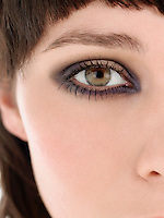 Eye of young woman wearing make-up close up