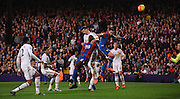 The combination of Damien Delaney and Yannick Bolasie head another effort over during the Barclays Premier League match between Crystal Palace and Manchester United at Selhurst Park, London, England on 31 October 2015. Photo by Michael Hulf.
