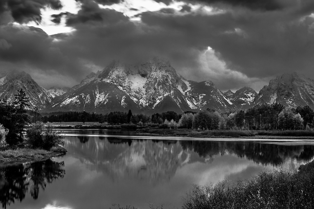 Mt. Moran partially reflected in the Snake River in Grand Teton National Park at Oxbow Bend on a gloomy Fall Day. Black and White version.