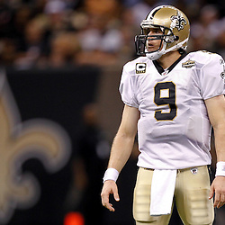 September 9, 2010; New Orleans, LA, USA;  New Orleans Saints quarterback Drew Brees (9) stands on the field during the fourth quarter of the NFL Kickoff season opener against the Minnesota Vikings at the Louisiana Superdome. The New Orleans Saints defeated the Minnesota Vikings 14-9.  Mandatory Credit: Derick E. Hingle