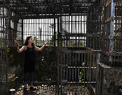 March 3, 2016 - Charlesville, Liberia - JENNY DESMOND gives a tour to KATHLEEN CONLEE of HSUS of cages that once held research chimps captive and now sit decaying as a team from HSUS visit Liberia in West Africa to observe efforts to save research chimpanzees abandoned by New York Blood Center, which stopped all funding for food and water when they retired the chimps formerly used for experimentation.  The Humane Society of the United States and New York Blood Center came to an agreement recently in May 2017 after years of discussion about the care of research chimps .  .  They also refused to pay their original caregivers who had worked for the center and were abandoned as well.  They initially used their own meager finances to continue feeding them.  Over 60 chimps now live on six islands serving as a sanctuary LCR (Liberian Chimpanzee Rescue), a project of Humane Society of the United States run by Jenny and James Desmond to improve the dire situation in which the chimpanzees were left to die. (Credit Image: © Carol Guzy via ZUMA Wire)