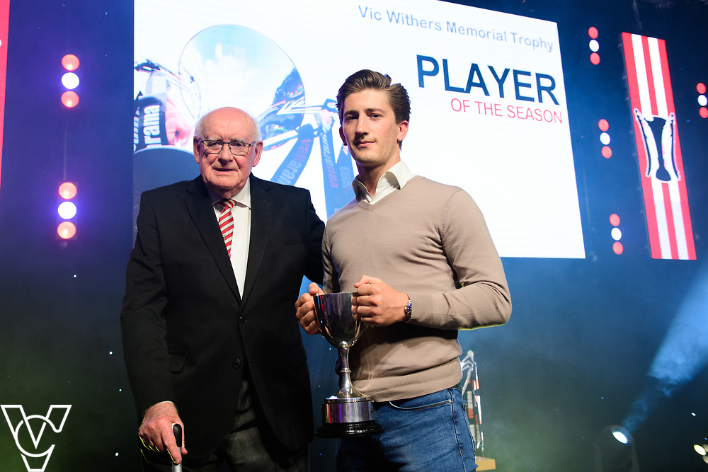Lincoln City Football Club's 2016/17 End of Season Awards night - Championship Seasons Awards Dinner - held at the Lincolnshire Showground.<br /> <br /> PLAYER OF THE SEASON:  Brian Baldam, from Lincoln and District Football Supporters Club, left, presents the Vic Withers Memorial Trophy for Player of the Season to Alex Woodyard.<br /> <br /> Picture: Chris Vaughan Photography for Lincoln City Football Club<br /> Date: May 20, 2017