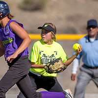070113       Cable Hoover<br /> <br /> Din&eacute; Nation Wildcat shortstop moves to throw to third to stop Grants Dynamite Justine Otero (4) during the district tournament Monday at Ford Canyon Park in Gallup.