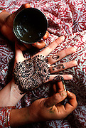 INDIA, PORTRAITS Traditional pattern or 'mehndi'; decorative design of henna dye applied to palm of hand
