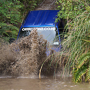 Vehicles navigate the elements at Off Road NZ, a sustainable premium adventure four wheel driving experience.  Off Road NZ is located on a beautiful NZ native bush clad property on the Mamaku Plateau, just 20 minutes north of Rotorua City. The formerly volcanic landscape offers diverse terrain for self-drive 4WD vehicles and other adventures.  Amoore Road, Rotorua, New Zealand. 13th December 2010 Photo Tim Clayton