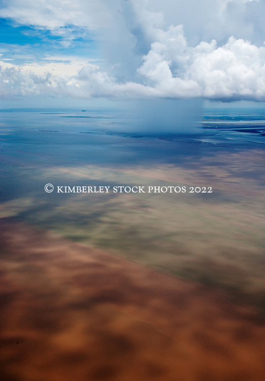 A storm brings rain to Cambridge Gulf in the east Kimberley wet season.  The flow of fresh water flushes mud from the rivers in the saltwater on the coast.
