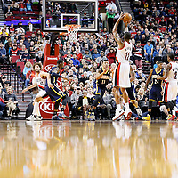 02 December 2013: Portland Trail Blazers power forward LaMarcus Aldridge (12) takes a jumpshot over Indiana Pacers shooting guard Orlando Johnson (11) during the Portland Trail Blazers 106-102 victory over the Indiana Pacers at the Moda Center, Portland, Oregon, USA.