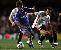 Photo: Paul Thomas.<br /> Chelsea v Valencia. UEFA Champions League. Quarter Final, 1st Leg. 04/04/2007.<br /> <br /> Didier Drogba (L) of Chelsea gets away from Emiliano Moretti.