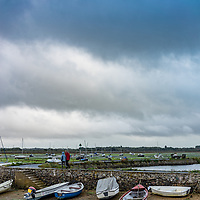 small rowing boats moored in Bosham harbour