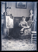 adult woman domestic indoors portrait France ca 1920s
