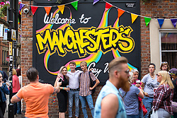 "© Licensed to London News Pictures . 25/08/2017. Manchester , UK. People on Canal Street in Manchester's "" Gay Village "" on the opening night of Manchester Pride's Big Weekend . The annual festival , which is the largest of its type in Europe , celebrates LGBT life . Photo credit: Joel Goodman/LNP"