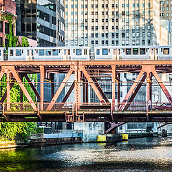 Panorama photo of Lake Street Bridge and an elevated L train over the Chicago River in downtown Chicago.