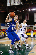 November 27th, 2010:  Anchorage, Alaska - Sophomore center for Drake, Seth VanDeest grabs a rebound in the Drake Bulldogs 81-82 loss to Weber State in the third place game at the Great Alaska Shootout.