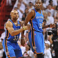 Jun 17, 2012; Miam, FL, USA; Oklahoma City Thunder point guard Derek Fisher (37) and small forward Kevin Durant (35) react during the first quarter in game three in the 2012 NBA Finals against the Miami Heat at the American Airlines Arena. Mandatory Credit: Derick E. Hingle-US PRESSWIRE