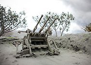 Old machine gun from World War Two covered with ash, Rabaul, New Britain Island, Papua New Guinea.