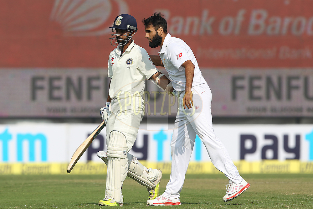 Imran Tahir of South Africa congratulates Ajinkya Rahane of India  on his innings during day two of the 4th Paytm Freedom Trophy Series Test Match between India and South Africa held at the Feroz Shah Kotla Stadium in Delhi, India on the 4th December 2015<br /> <br /> Photo by Ron Gaunt  / BCCI / SPORTZPICS