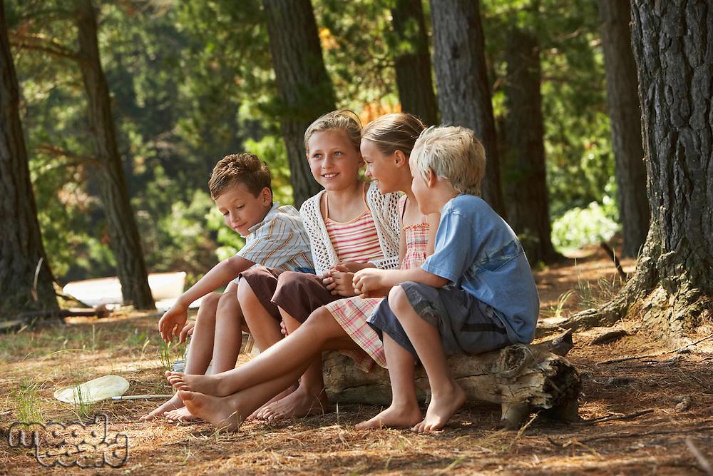 Four Children in Forest