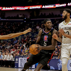 Dec 3, 2018; New Orleans, LA, USA; LA Clippers forward Montrezl Harrell (5) drives past New Orleans Pelicans forward Wesley Johnson (33) and forward Anthony Davis (23) and forward Solomon Hill (44) during the first quarter at the Smoothie King Center. Mandatory Credit: Derick E. Hingle-USA TODAY Sports