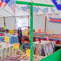 070213       Cable Hoover<br /> <br /> Customers peruse the selection of merchandise at the Cash Cow fireworks tent in Gallup Tuesday.