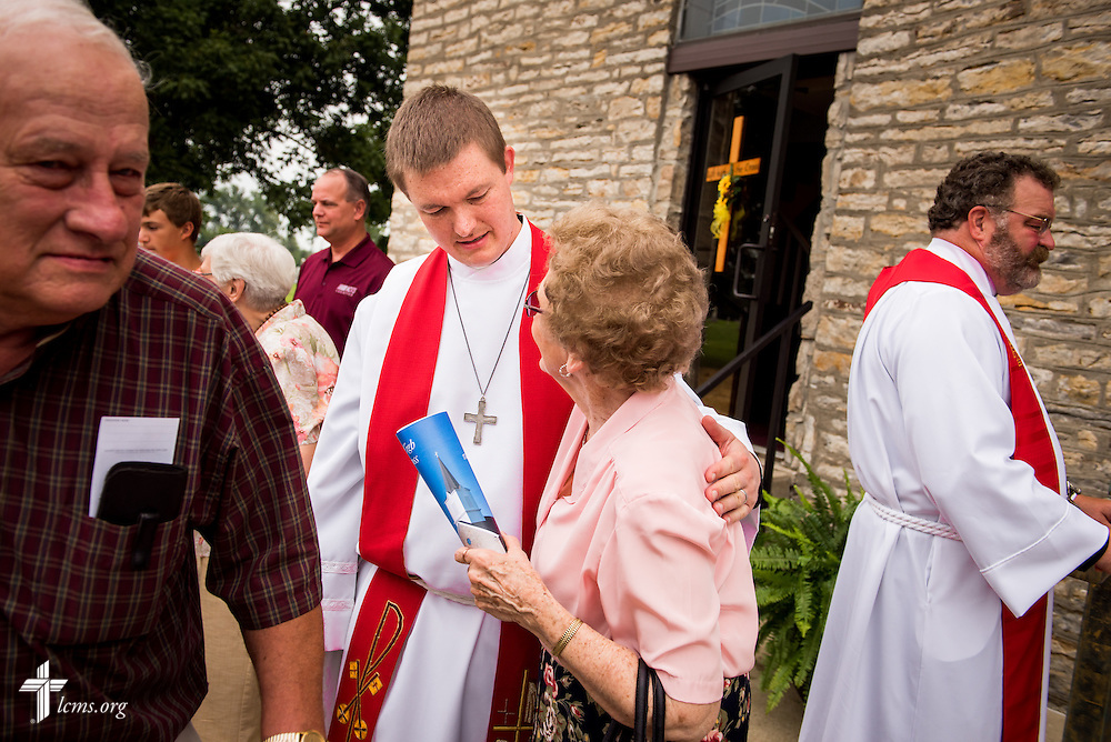 "The Rev. Jacob Mueller of Holy Cross Lutheran Church in Emma, Mo., thanks parishioner Eunice Hausler following worship on Sunday, August 9, 2015, during a ""Day of Thanksgiving and Rededication""  at St. John's Lutheran Church in New Minden, Ill. Nearly two years ago, a tornado damaged the church and surrounding homes., including Hausler's. To the right of Mueller is the Rev. Dr. Matthew C. Harrison, president of The Lutheran Church–Missouri Synod. LCMS Communications/Erik M. Lunsford"