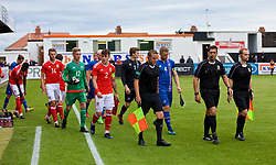 RHYL, WALES - Monday, September 4, 2017: Wales' captain Mitchell Clark and Iceland's captain Torfi T.Gunnarsson lead their teams out ahead of an Under-19 international friendly match between Wales and Iceland at Belle Vue. (Pic by Paul Greenwood/Propaganda)